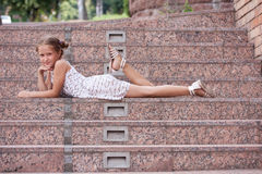 Girl lying on a stairs Royalty Free Stock Images