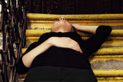Girl lying on the stairs Royalty Free Stock Images