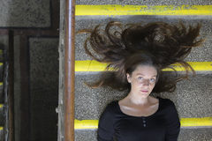 Girl lying on the stairs Stock Images