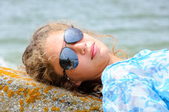 Girl is lying on stone Royalty Free Stock Photo