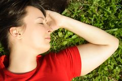Girl lying on summer meadow Royalty Free Stock Photography