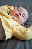 Girl lying supine sleeping Royalty Free Stock Photography