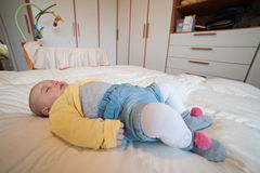 Girl lying supine sleeping. On a bed Royalty Free Stock Images