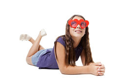 Girl lying think about love. With a pair of glasses heart shape Stock Images