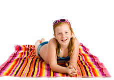 Girl lying on a towel Royalty Free Stock Images
