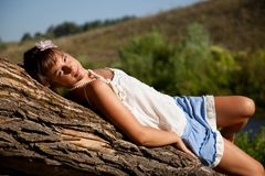 Girl is lying on a tree Stock Image