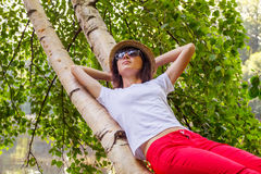 Girl lying on the tree Royalty Free Stock Image