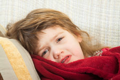Girl lying under a blanket Stock Photo