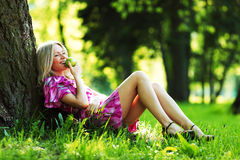 Girl lying under a tree Royalty Free Stock Photos