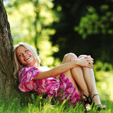 Girl lying under a tree Royalty Free Stock Photography