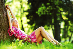 Girl lying under a tree Royalty Free Stock Image