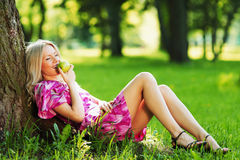 Girl lying under a tree Stock Images