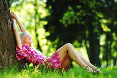 Girl lying under a tree Royalty Free Stock Images