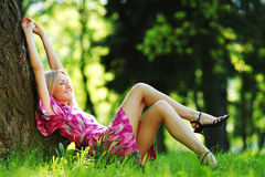 Girl lying under a tree Royalty Free Stock Photo