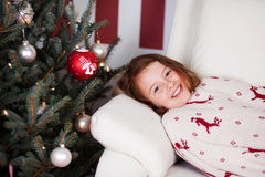 Girl lying waiting for the Christ Child Royalty Free Stock Photo
