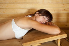 Girl lying in  sauna Stock Photos