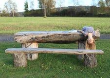 Girl lying on wooden table Stock Photos
