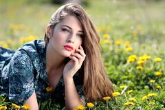 Girl Lying on Yellow Flower Field during Daytime royalty free stock image