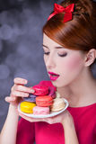 Girl with macaron Stock Photos