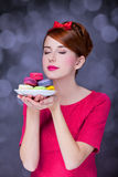 Girl with macaron Stock Images