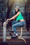Girl machine gym cycling Stock Photos