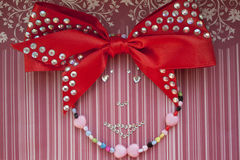 The girl made beaded and rhinestones. The girl`s face made of beads and rhinestones on a red background, handmade Royalty Free Stock Images