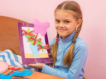Girl made a birthday card for mom on Mothers Day. The girl made a birthday card for mom on Mothers Day Stock Photo