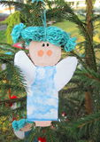 Girl made from paper. Christmas decoration Royalty Free Stock Photo