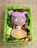 The girl  is made of rice. Kyaraben, bento Stock Photography