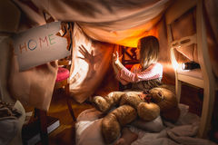 Girl made theater of shadows in self-made house at bedroom Stock Photos