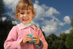 Girl with magic cube outdoor Stock Photo