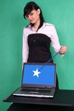 Girl with magic wand and laptop with blank screen. Stock Photo