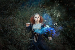 Girl with a magic wand. Royalty Free Stock Photos