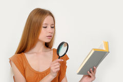 Girl with magnifier Royalty Free Stock Photography