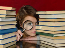 The girl and magnifier. Stock Photo
