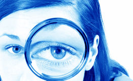 Girl with a magnifier Stock Photo