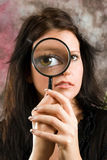 Girl with magnifier Stock Photos