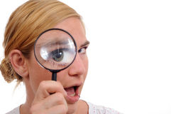 Girl, magnifier. Girl with a magnifying glass checking Stock Photo