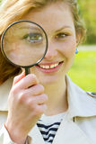 Girl with magnifier Royalty Free Stock Photo