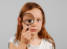Girl with Magnifiying Glass Stock Photography