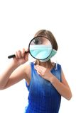 Girl and magnify glass Stock Photography