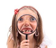Girl and magnify her face royalty free stock photos