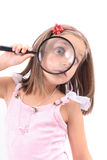 Girl and magnify her face. On white background Stock Image