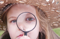 Girl with magnifying glass Royalty Free Stock Photography