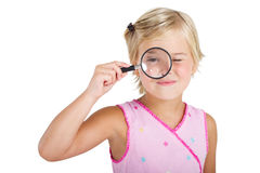 Girl with magnifying glass Stock Photography