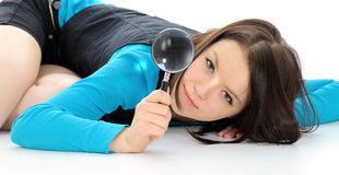 Girl with magnifying glass. Royalty Free Stock Image