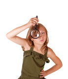 Girl with magnifying glass. Royalty Free Stock Photos