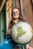 Girl with magnifying glass and globe. education kids concept. Little girl with magnifying glass and globe. education kids concept stock photography