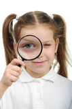 Girl with magnifying glass Stock Photo