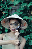 Girl with magnifying magnifying glass Royalty Free Stock Photo